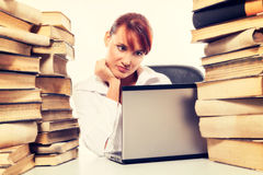 Education concept. Beautiful young woman with stack of books with her laptop on white background Royalty Free Stock Photos