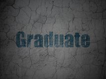 Education concept: Graduate on grunge wall background Royalty Free Stock Photography