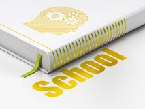 Education concept: book Head With Gears, School on white background. Education concept: closed book with Gold Head With Gears icon and text School on floor Royalty Free Stock Images