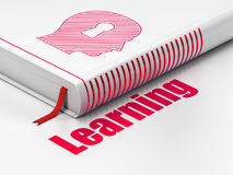 Education concept: book Head With Keyhole, Learning on white background. Education concept: closed book with Red Head With Keyhole icon and text Learning on Royalty Free Stock Image