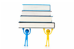Education concept - book and smilie on white Royalty Free Stock Image