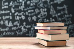 Education concept - books on the desk in the auditorium. 1 stock image