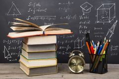 Education concept - books on the desk in the auditorium. Education concept  books on the desk in the auditorium royalty free stock photography