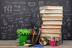 Education concept - books on the desk in the auditorium. Education concept  books on the desk in the auditorium royalty free stock images