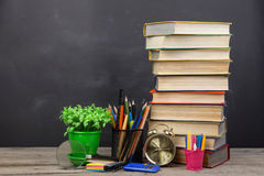 Education concept - books on the desk in the auditorium. Education concept books on the desk in the auditorium royalty free stock photos