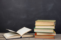 Education concept - books on the desk in the auditorium. Education concept -books on the desk in the auditorium royalty free stock image