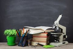Education concept books on the desk in the auditorium royalty free stock image