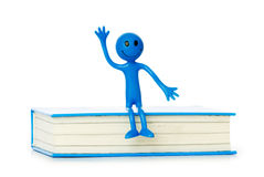 Education concept - books and smilie Royalty Free Stock Photo