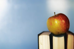 Education concept books stack, apple and pen Royalty Free Stock Photography