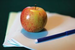 Education concept books stack, apple and pen Stock Photo