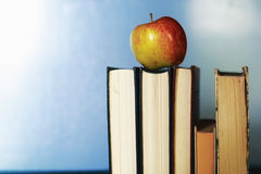 Education concept books stack, apple and pen Royalty Free Stock Image