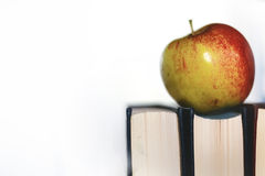 Education concept books stack, apple and pen Royalty Free Stock Photo