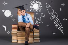 Education concept. Boy dreaming of space travel Royalty Free Stock Photos
