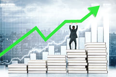 Education concept business chart. Education concept with man standing on book stairway and upholding green arrow on business chart background. 3D Rendering Stock Photography