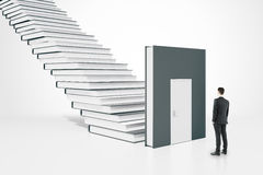 Education concept businessman. Education concept with businessman standing next to book door and ladder. 3D Rendering Stock Photography