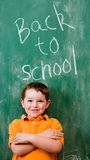 Education concept with child and chalkboard Royalty Free Stock Photo