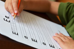 Education Concept With Child Learning To Write Stock Photo