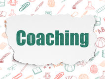 Education concept: Coaching on Torn Paper Royalty Free Stock Photography