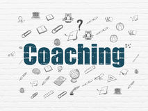 Education concept: Coaching on wall background Royalty Free Stock Image