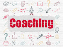Education concept: Coaching on wall background Stock Photos