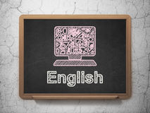 Education concept: Computer Pc and English on chalkboard background Stock Photo