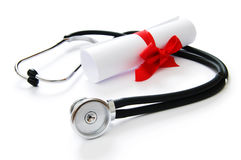 Education concept with diploma and stethoscope