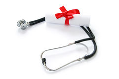 Education concept with diploma and stethoscope Stock Photos