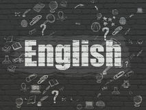 Education concept: English on wall background. Education concept: Painted white text English on Black Brick wall background with Scheme Of Hand Drawn Education Stock Photos