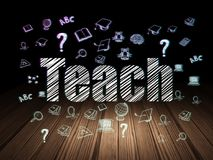 Education concept: Teach in grunge dark room. Education concept: Glowing text Teach,  Hand Drawn Education Icons in grunge dark room with Wooden Floor, black Royalty Free Stock Image