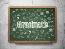 Education concept: Graduate on School board background Stock Photography