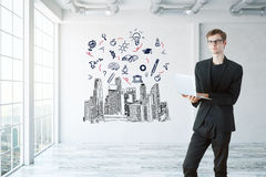 Education concept. Handsome young businessman using laptop in modern interior with city view and sketch on wall. Education concept. 3D Rendering Stock Images