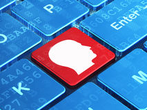 Education concept: Head on computer keyboard Royalty Free Stock Image