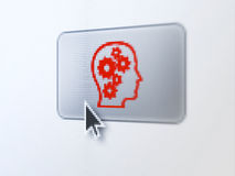 Education concept: Head With Gears on button. Education concept: pixelated Head With Gears on button with Arrow cursor on digital computer screen, selected focus Stock Photo