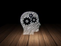 Education concept: Head With Gears in grunge dark. Education concept: Glowing Head With Gears icon in grunge dark room with Wooden Floor, black background, 3d Royalty Free Stock Image
