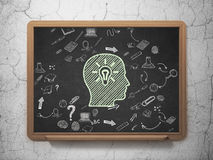 Education concept: Head With Light Bulb on School Royalty Free Stock Photo