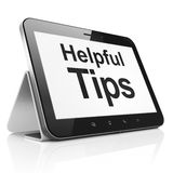 Education concept: Helpful Tips on tablet pc. Education concept: black tablet pc computer with text Helpful Tips on display. Modern portable touch pad on White Stock Photo