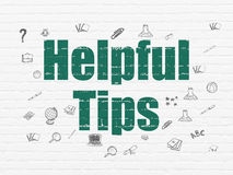 Education concept: Helpful Tips on wall background Royalty Free Stock Photos