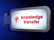 Education concept: Knowledge Transfer and Head. With Gears on advertising billboard background, 3d render Stock Photography