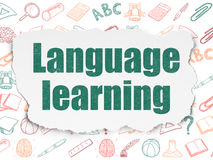 Education concept: Language Learning on Torn Paper Stock Images