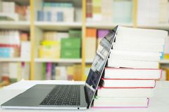 Education concept. Laptop with books, royalty free stock photos