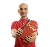 Education concept. Learn English. Handsome man with book. Isolated over white Stock Photos