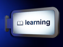 Education concept: Learning and Book on billboard background Royalty Free Stock Photo