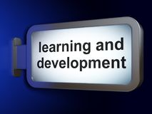 Education concept: Learning And Development on billboard background Royalty Free Stock Photo