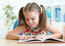 Education concept - little student kid reading Royalty Free Stock Photography