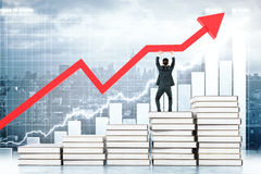 Education concept man upholding arrow. Education concept with man standing on book stairway and upholding red arrow on business chart background. 3D Rendering Stock Image