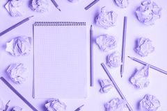 Education concept: notebook with pencils and crumpled paper ball. top view, flat lay. royalty free stock photos
