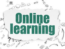 Education concept: Online Learning on Torn Paper Stock Photography