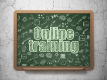Education concept: Online Training on School Board. Education concept: Chalk Green text Online Training on School Board background with  Hand Drawn Education Royalty Free Stock Photo