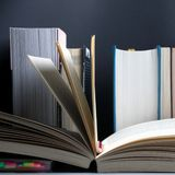 Education concept. Open book on background of bookshelf with row of important books royalty free stock image