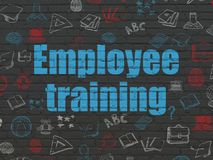 Education concept: Employee Training on wall background. Education concept: Painted blue text Employee Training on Black Brick wall background with Hand Drawn royalty free stock photos